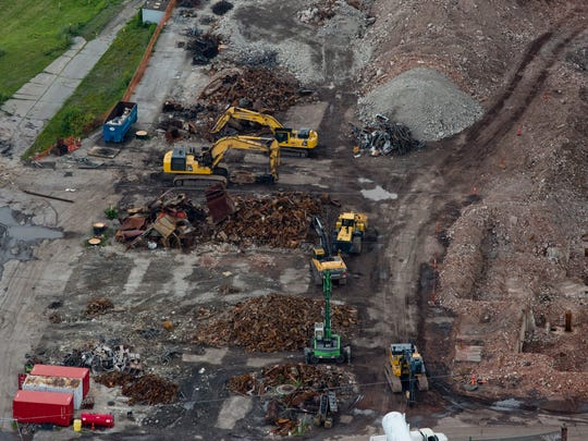 An aerial view of scrap piles surrounding the former DTE plant July 18, 2015 in Marysville.