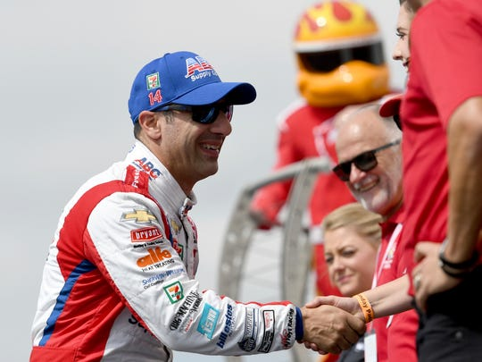 Tony Kanaan (14) is introduced prior to the start of the IndyCar Firestone Grand Prix of St. Petersburg Sunday, March 11, 2018, in St. Petersburg, Fla. (AP Photo/Jason Behnken)