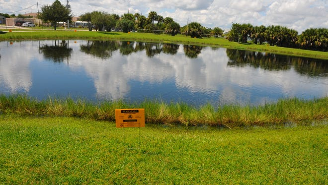 Contaminated water warning signs surround South Patrick Community Park on Sea Park Boulevard in 2016, where some of the sewage water was dumped. Workers completed repairs to a sewer main that leaked up to 750,000 gallons of sewage into several surrounding canals and overflow ponds, Brevard County Emergency Management office said.