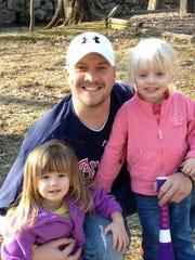 Phillip Jackson and his children. Jackson was killed