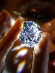 Photo shows a 102.34- carat flawless white diamond