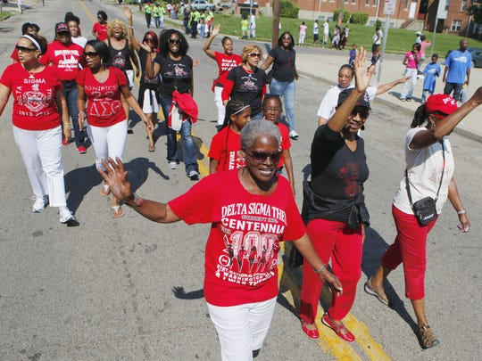 The women of the Delta Sigma Theta Sorority march during the Black Family Reunion parade last year.