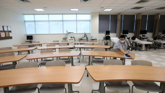 Raymond Bilalaj cleans a classroom at Health Professions Integrated Teaching Center, at Bergen Community College, in Paramus, in March 2020.