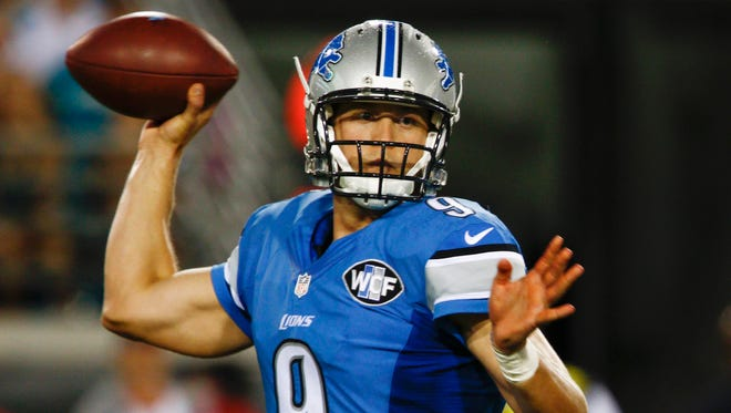 Detroit Lions quarterback Matthew Stafford (9) prepares to throw the ball during the first quarter of  an NFL preseason football game against the Jacksonville Jaguars at EverBank Field on Friday, Aug. 28, 2015.