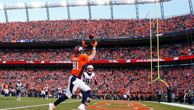 Jan 24, 2016; Denver, CO, USA; Denver Broncos tight end Owen Daniels (81) catches a touchdown pass over New England Patriots outside linebacker Jamie Collins (91) in the second quarter in the AFC Championship football game at Sports Authority Field at Mile High. Mandatory Credit: Kevin Jairaj-USA TODAY Sports
