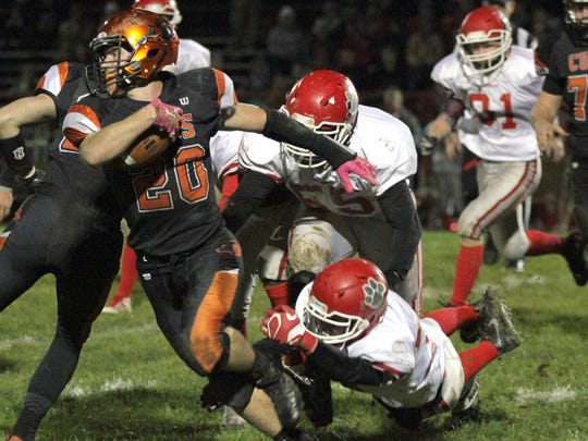 Lucas' Jackson Hauger carries the ball against Trimble during a regional quaterfinal at home on Friday.