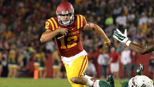 Iowa State Cyclones quarterback Sam Richardson (12) runs for a first down against the Baylor Bears at Jack Trice Stadium.