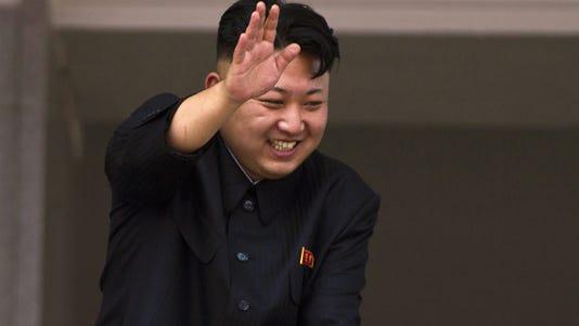 A 2013 photo shows North Korean leader Kim Jong Un waving to veterans.