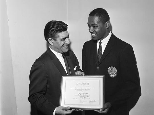 Jerry Harkness, right, star forward of Loyola University