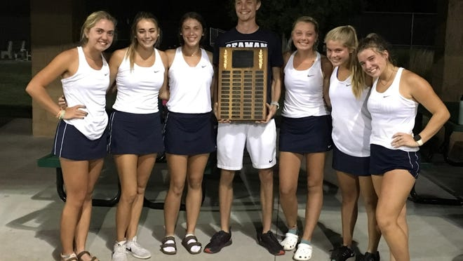 Seaman's girls tennis team poses with its championship plaque after winning Thursday's city title by a 27-26 margin over Hayden.