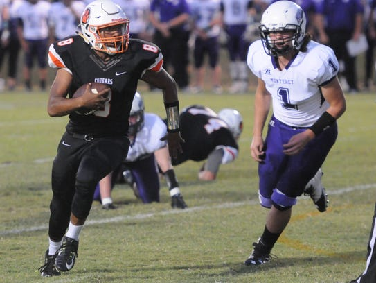 MTCS quarterback heads to the end zone on an 11-yard