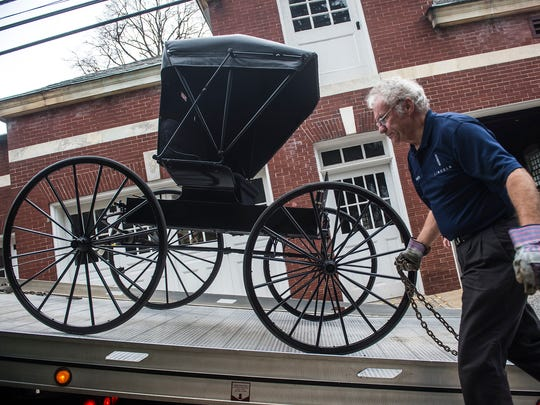 Ken Cooper of Cooper Motors moves the courting buggy to its new location at the Carriage House on Nov. 18, 2015.