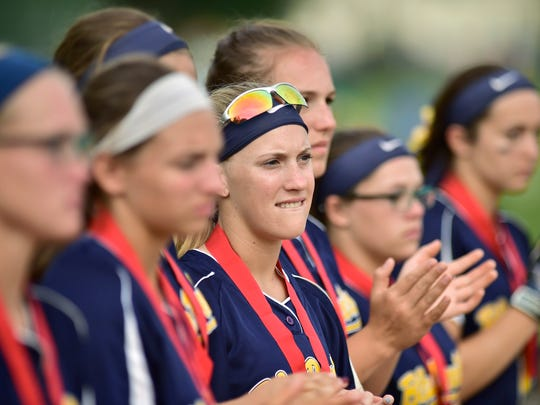 Blue Devil teammates can only watch as Donegal players get their trophy and medals. Greencastle-Antrim challenged Donegal in the D-3 Class AAA  softball championship game on Thursday, June 2, 2016. Donegal won 6-5 in extra innings.