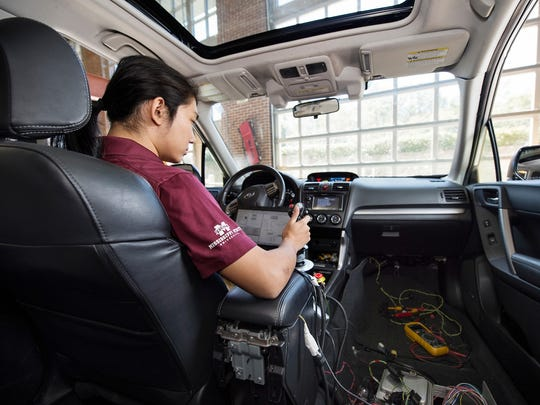 David Zhu, a senior mechanical engineering major from Clinton, is one of the Mississippi State University students working on the 'Halo' Project supercar, an all-electric and self-driving sport utility vehicle.