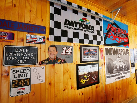 A variety of  NASCAR, Indy 500 and Corvette memorabilia decorate the garage of Tom Hetrick Wednesday, May 16, 2018, near West Lebanon.