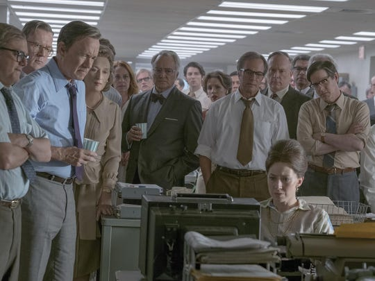 """Howard Simons (David Cross), left, Frederick """"Fritz"""" Beebe (Tracy Letts), Ben Bradlee (Tom Hanks), Kay Graham (Meryl Streep), Arthur Parsons (Bradley Whitford), Chalmers Roberts (Philip Casnoff), Paul Ignatius (Brent Langdon), and Meg Greenfield (Carrie Coon, seated) are featured in """"The Post."""""""