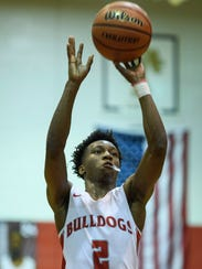 During the fourth quarter, Bosse's Mekhi Lairy makes a free-throw shot that allowed him to break the school's career scoring record during a home game against the Memorial Tigers in Evansville, Ind., Dec. 12, 2017. Lairy is also now the all-time leading scorer in city history.