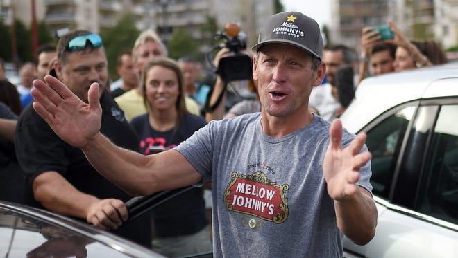 Armstrong made an appearance at a charity bike race in France in July.