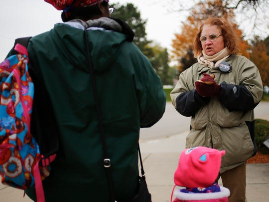 Roberta McCall talks to people outside the Ingham County Human Services building Wednesday, Nov. 1, 2017, about the campaign called Voters Not Politicians, who seek to put a state Constitutional amendment on the 2018 ballot to end gerrymandering.
