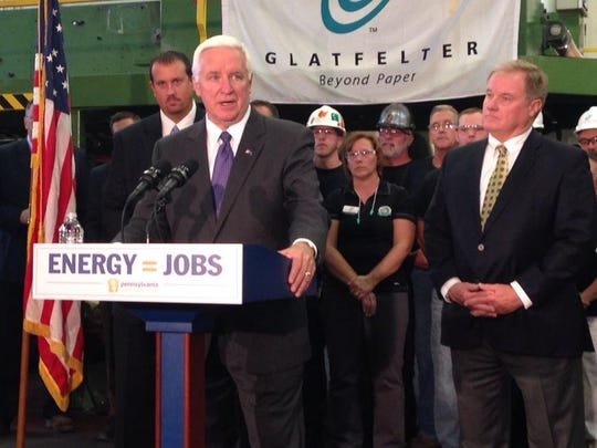 Then-Gov. Tom Corbett, center, speaks during a news conference in September 2014 at Glatfelter's Spring Grove mill. Corbett announced a $5 million Economic Growth Initiative Grant and a $3-million Alternative and Clean Energy Grant to help the mill convert to natural gas for its boilers.