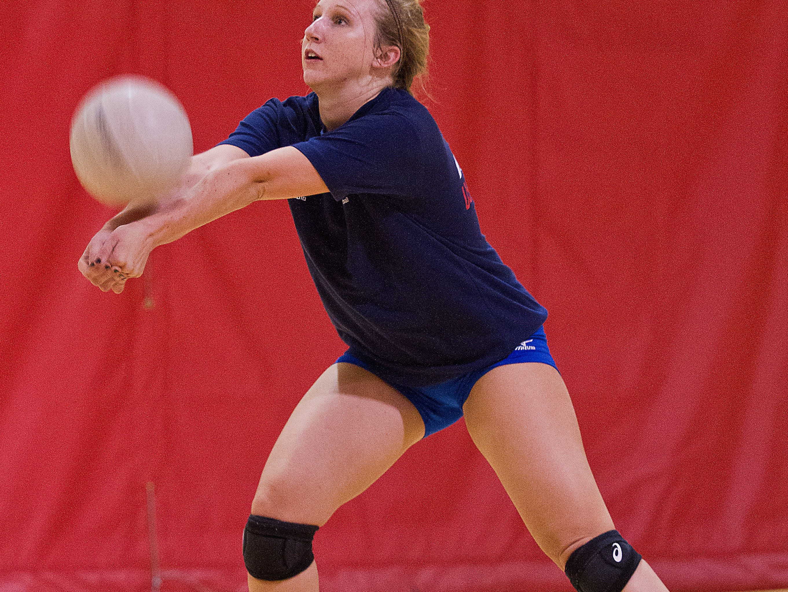 Emily Moore of ECS in Fort Myers keeps the ball in play during a volleyball team practice drill Monday (10/19/15).