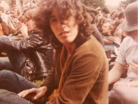 "Bruce Springsteen in the crowd at Monmouth College, watching another band perform before his band, ""Child,"" takes the stage, 1969."