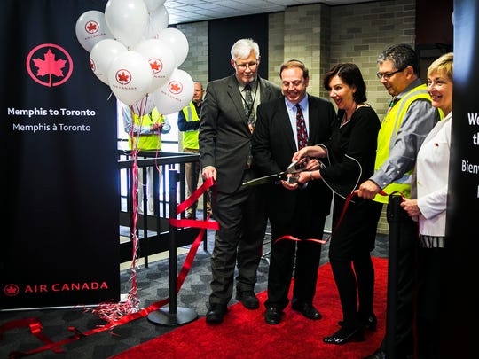 May 1, 2017 - (Left to right) - Scott Brockman, president and CEO, Memphis Airport Authority, Pace Cooper, chairman, Memphis Airport Authority, Lisa Pierce, senior director of USA sales and market development, Air Canada, Joseph Salazar, manager, airports for South East - USA, Air Canada, and Lisa Stockley, consul and trade commissioner for consulate general of Canada, based in Atlanta, celebrate during a ribbon cutting ceremony to welcome the first Air Canada flight from Toronto to Memphis, after a five-year absence, at the Memphis International Airport on Monday.