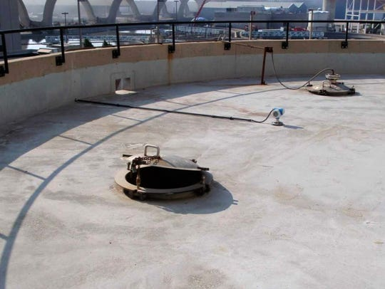 An open hatch releases odors from a sludge blending tank at the Jones Island sewage treatment plant in Milwaukee.