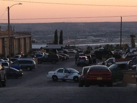 El Paso police block the street at the scene of a SWAT