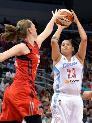 Atlanta's Shoni Schimmel, right, attempts a shot over the defense of Washington's Emma Meesseman during their game Saturday, May 23, 2015, at the KFC Yum! Center. (Photo by Timothy D. Easley/Special to the C-J)