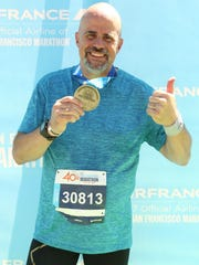 Fond du Lac resident Joel Padovano is pictured after his run at the San Francisco Marathon.