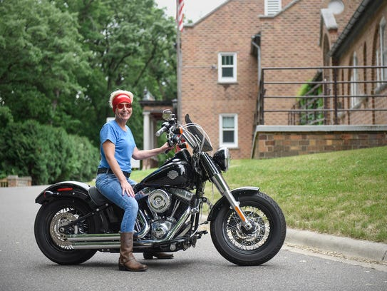 Moe Janssen poses with her motorcycle Friday, June