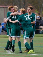 Yorktown's Timmy O'Callaghan (11) celebrates scoring