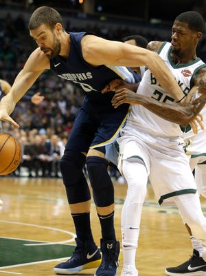 Bucks guard DeAndre Liggins guards Grizzlies center Marc Gasol (33) during the first half Monday night at the BMO Harris Bradley Center.