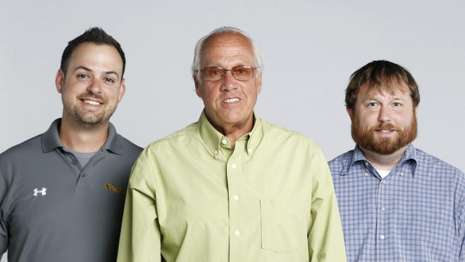 KXnO Radio's Chris Williams and the Register's Randy Peterson and Tommy Birch.