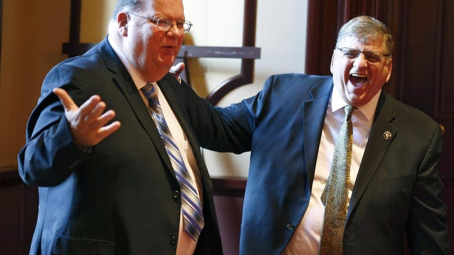 Ocean County Sheriff Michael Mastronardy (right) jokes with Freeholder John P. Kelly before his swearing in ceremony held at the Ocean County Courthouse in Toms River, NJ, Wednesday, January 4, 2017. Also sworn in were Undersheriffs Nils R. Bergquist and Brian J. Klimakowski.