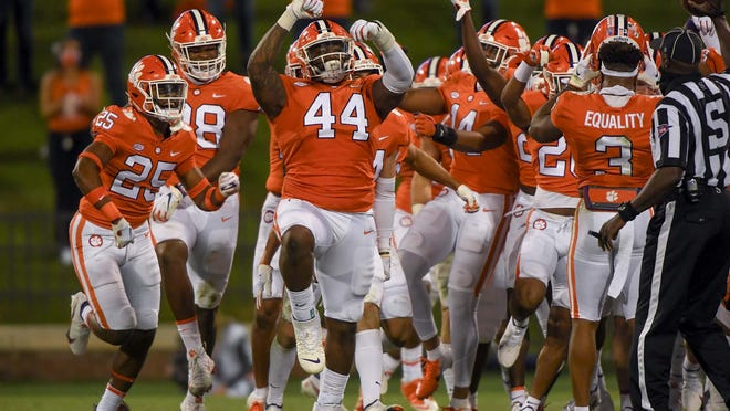 Clemson defensive tackle Nyles Pinckney (44) reacts after a Tigers interception during the third quarter of last week's victory over Virginia.