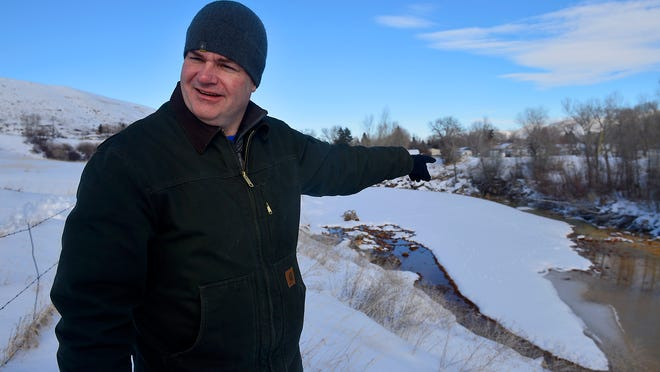 """In winter 2015, Tom Henderson of the Montana Department of Environmental Quality's Abandoned Mine Lands Program visited Belt Creek in the town of Belt where mine drainage empties into the creek, staining the creek bed a rust color. """"He was really diligent in the work he was doing and he believed in it,"""" said Jim Larson, a Cascade County Commissioner, of Henderson's efforts to end the pollution. Henderson died in October."""