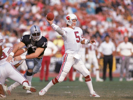 Quarterback Gary Hogeboom (5) of the Phoenix Cardinals throws a pass during a game against the Los Angeles Raiders at the Los Angeles Memorial Coliseum on December 10, 1989 in Los Angeles, California.