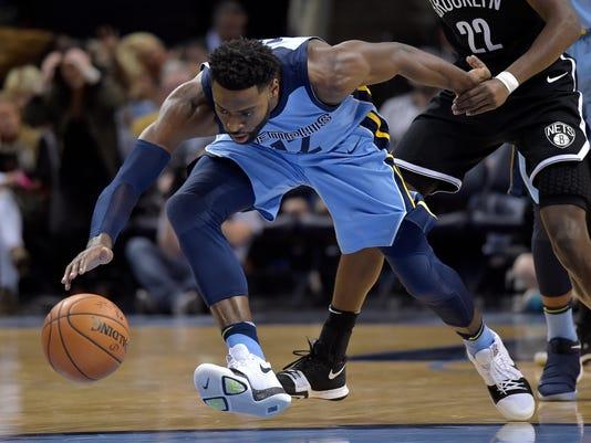 Memphis Grizzlies guard Tyreke Evans (12) reaches for the ball in the first half of an NBA basketball game against the Brooklyn Nets, Sunday, Nov. 26, 2017, in Memphis, Tenn. (AP Photo/Brandon Dill)