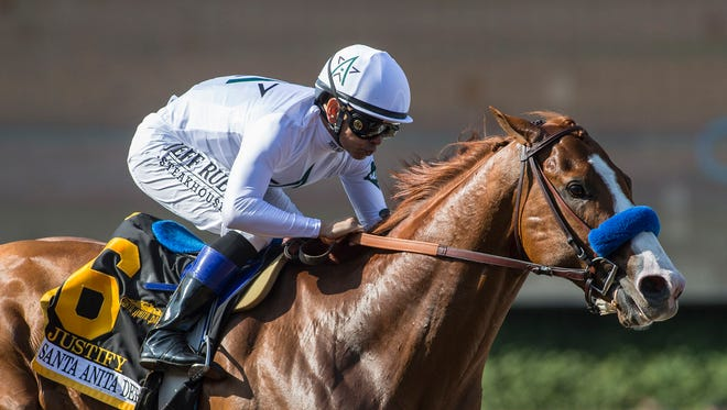 In a photo provided by Benoit Photo, Justify and Mike Smith win the Santa Anita Derby horse race Saturday, April 7, 2018, at Santa Anita in Arcadia, Calif.