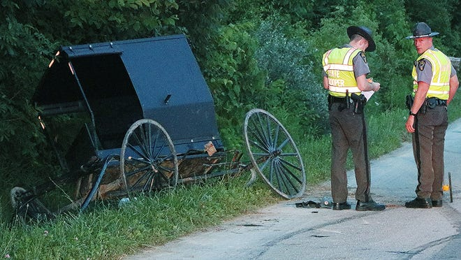 Ohio State Highway Patrol troopers investigate a buggy crash on County Road 620 in Jackson Township.