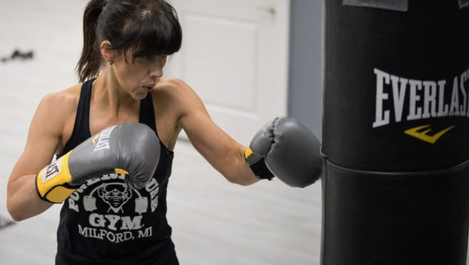 Jaime Hockin gets in a cardiovascular workout with some boxing at Powerhouse Gym of Milford.