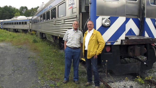 David Blittersdorf, right, and Charlie Moore have purchased a dozen passenger rail cars to try to jump-start a commuter rail system in Vermont.