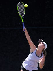 Wylie's Hailey Parker serves during the Class 4A girls