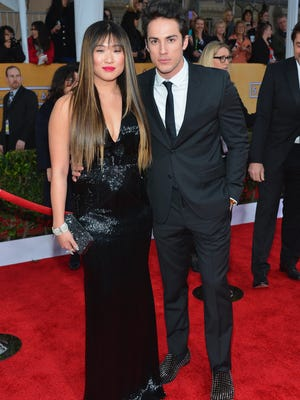 Actress Jenna Ushkowitz and Michael Trevino arrive at the 19th Annual Screen Actors Guild Awards held at The Shrine Auditorium on January 27, 2013 in Los Angeles, California.