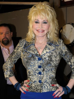 Dolly Parton in Nashville last year -- solo as usual.