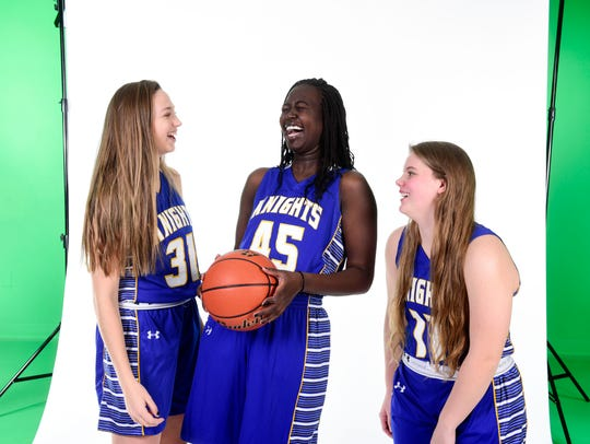 O'Gorman's Emma Ronsiek, Awoti Akoi and McKenzie Hermanson