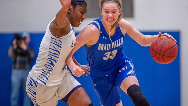 Grain Valley guard Grace Slaughter (33), who earned all-state honors and broke school records as a freshman, announced her verbal commitment to Missouri on Saturday, with three high school seasons remaining before she heads to college.