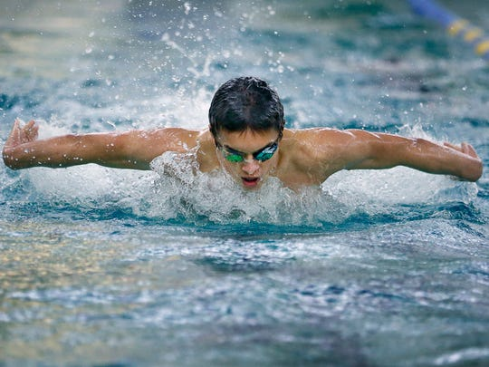 """AGR swimmer Sam Rivera is a Brighton freshman that has overcome many obstacles in his life, including being diagnosed with Tourette Syndrome. He uses his illness as a """"secret weapon,'' helps his quick starts out of the blocks. He's seen here swimming freestyle during practice at Irondequoit High School."""